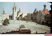 A Deutsche Reichsbahn bus parked on the square in Leitmeritz / North Bohemia (today Litoměřice, Czech) against the backdrop of Rathaus (City Hall) and Allerheiligen Kirche (All Saints Church). The picture was taken in 1938.